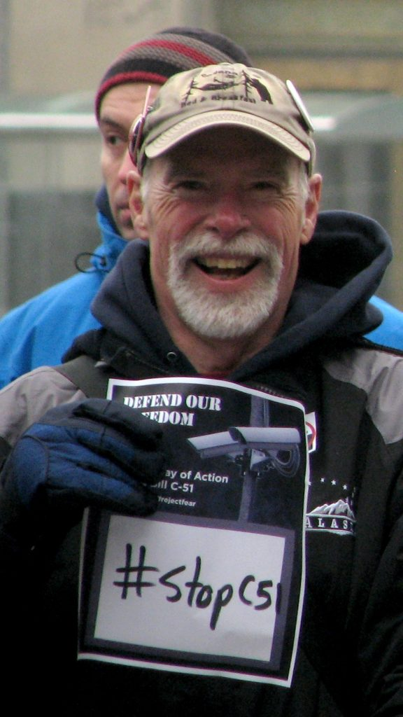 "Oz Cole-Arnal holding a ""Stop C51"" sign"