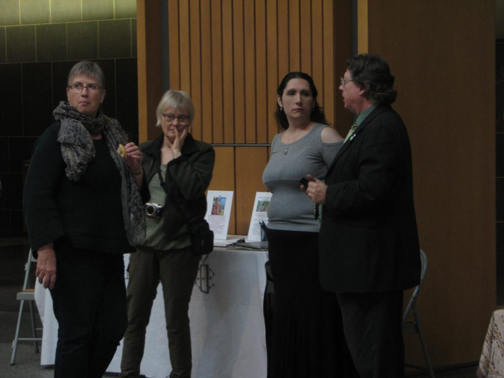People in discussion before the presentation