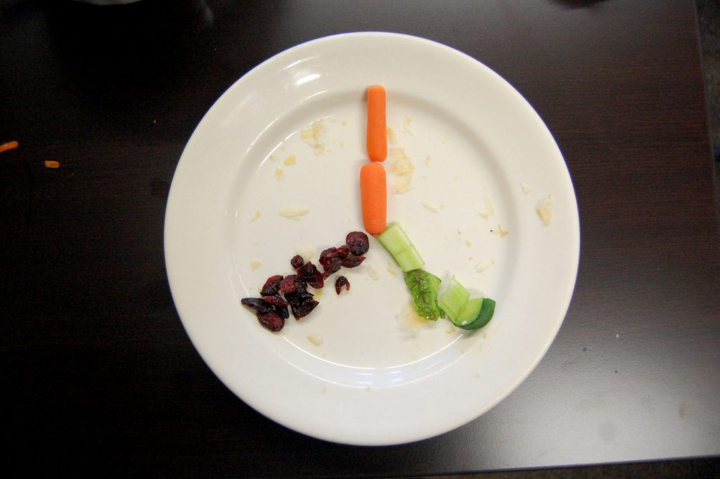 Vegetables on a plate in the shape of a Peace sign